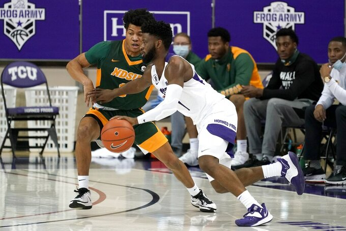 North Dakota State guard Dezmond McKinney (0) defends as TCU guard Mike Miles (1) works on the perimeter in the first half of an NCAA college basketball game in Fort Worth, Texas, Tuesday, Dec. 22, 2020. (AP Photo/Tony Gutierrez)