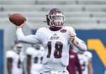 Eastern Kentucky quarterback Parker McKinney (18) throws a pass against West Virginia during an NCAA college football game on Saturday, Sept. 12, 2020, in Morgantown, W.Va.  (William Wotring/The Dominion-Post via AP)