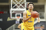 FILE - In this Jan. 19, 2020, file photo, Montverde Academy's Cade Cunningham shoots a free throw against IMG Academy during a high school basketball game at the Hoophall Classic in Springfield, Mass. Oklahoma State freshman Cade Cunningham has made The Associated Press 2020-21 NCAA college basketball preseason All-America team, announced Wednesday, Nov. 11. (AP Photo/Gregory Payan, File)