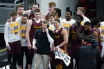 Loyola of Chicago players celebrate with head coach Porter Moser after beating Illinois in a college basketball game in the second round of the NCAA tournament at Bankers Life Fieldhouse in Indianapolis Sunday, March 21, 2021. Loyola upset Illinois 71-58. (AP Photo/Mark Humphrey)