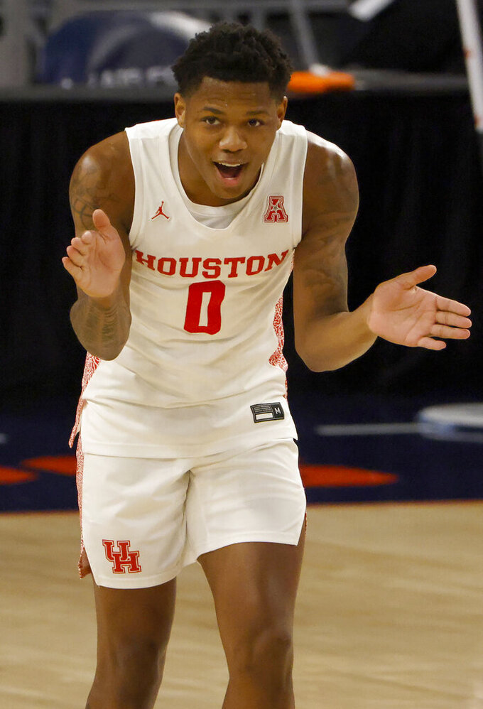 Houston guard Marcus Sasser (0) reacts after scoring against the Memphis during the first half of an NCAA college basketball game in the semifinal round of the American Athletic Conference tournament Saturday, March 13, 2021, in Fort Worth, Texas. (AP Photo/Ron Jenkins)