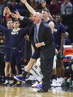 Navy head coach Ed DeChellis reacts to a call during an NCAA college basketball game against Virginia in Charlottesville, Va., Sunday, Dec. 29, 2019. (AP Photo/Andrew Shurtleff)
