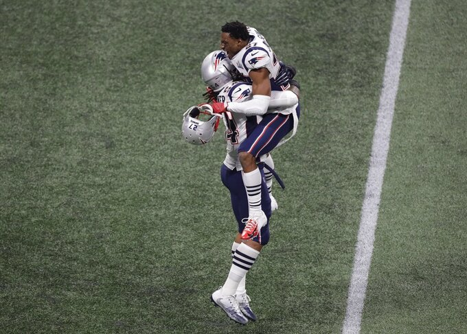 New England Patriots' J.C. Jackson (27) and New England Patriots' Dont'a Hightower (54) celebrate after the NFL Super Bowl 53 football game against the Los Angeles Rams, Sunday, Feb. 3, 2019, in Atlanta. The Patriots won 13-3. (AP Photo/Charlie Riedel)