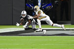 Las Vegas Raiders wide receiver Zay Jones, left, catches a touchdown against New Orleans Saints free safety Marcus Williams (43) during the first half of an NFL football game, Monday, Sept. 21, 2020, in Las Vegas. (AP Photo/David Becker)