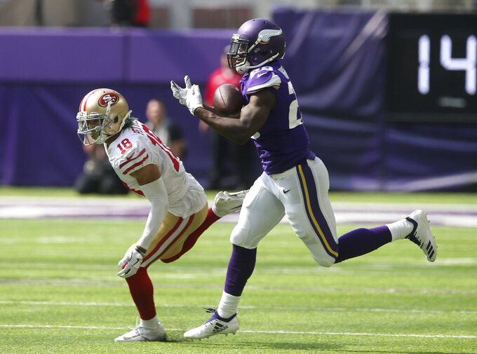 FILE - In this Sept. 9, 2018, file photo, Minnesota Vikings defensive back Xavier Rhodes, right, intercepts a pass intended for San Francisco 49ers wide receiver Dante Pettis during the second half of an NFL football game in Minneapolis. Rhodes, whose play was affected by injury last year, is one of several players being counted on to help get the team back to the playoffs. (AP Photo/Jim Mone, File)