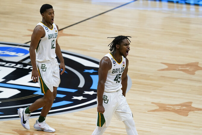Baylor guard Davion Mitchell (45) and Jared Butler (12) celebrate after a play against Houston during the first half of a men's Final Four NCAA college basketball tournament semifinal game, Saturday, April 3, 2021, at Lucas Oil Stadium in Indianapolis. (AP Photo/Darron Cummings)