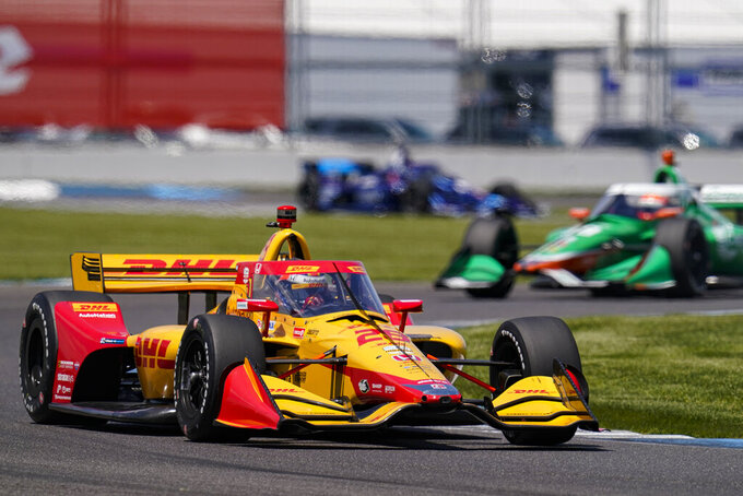 Ryan Hunter-Reay drives through a turn during practice for the IndyCar auto race at Indianapolis Motor Speedway in Indianapolis, Friday, May 14, 2021. (AP Photo/Michael Conroy)