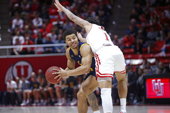 Utah forward Timmy Allen (1) guards California guard Matt Bradley, left, during the first half of an NCAA college basketball game Saturday, Feb. 8, 2020, in Salt Lake City. (AP Photo/Rick Bowmer)