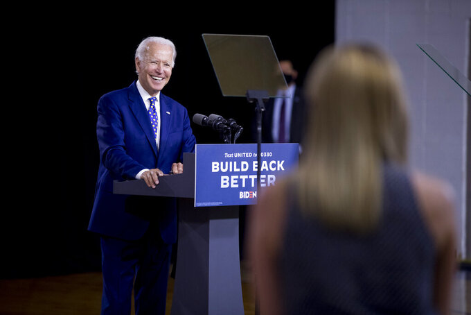 """Democratic presidential candidate former Vice President Joe Biden smiles as he takes a question from a reporter at a campaign event at the William """"Hicks"""" Anderson Community Center in Wilmington, Del., Tuesday, July 28, 2020.(AP Photo/Andrew Harnik)"""