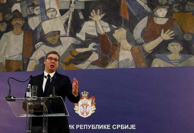 Serbian President Aleksandar Vucic speaks during a press conference in Belgrade, Serbia, Wednesday, March 4, 2020.  Serbia's president on Wednesday set April 26 as the date of new parliamentary election which many of the opposition parties plan to boycott because of his firm control of media and the electoral process. (AP Photo/Darko Vojinovic)