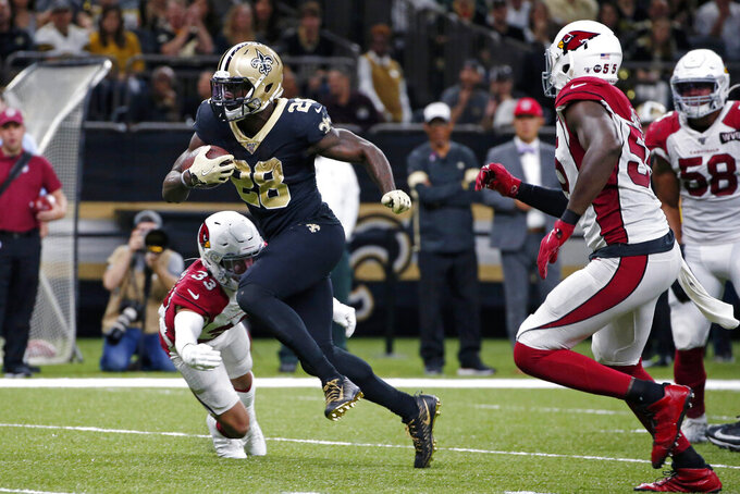New Orleans Saints running back Latavius Murray (28) carries past Arizona Cardinals cornerback Byron Murphy (33) in the first half of an NFL football game in New Orleans, Sunday, Oct. 27, 2019. (AP Photo/Butch Dill)