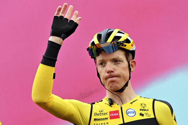 Steven Kruijswijk waves prior to the eight stage of the Giro d'Italian cycling race from San Salvo to Roccaraso, Sunday Oct. 11, 2020. All riders and team staff members were tested for COVID-19 over the last 48 hours coinciding with Monday's rest day with a total of571 tests performed. Team Jumbo-Visma announced thatSteven Kruijswijk came back positive and was withdrawn. (Gian Mattia D'Alberto/LaPresse via AP)