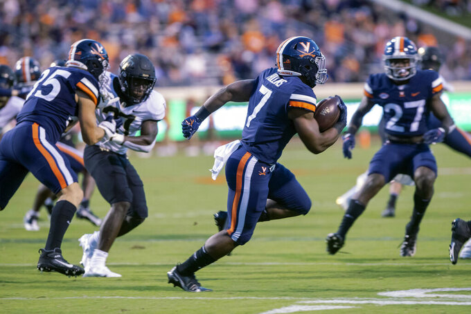 Virginia running back Mike Hollins (7) runs the ball against Wake Forest during an NCAA college football game Friday, Sept. 24, 2021, in Charlottesville, Va. (Erin Edgerton/The Daily Progress via AP)