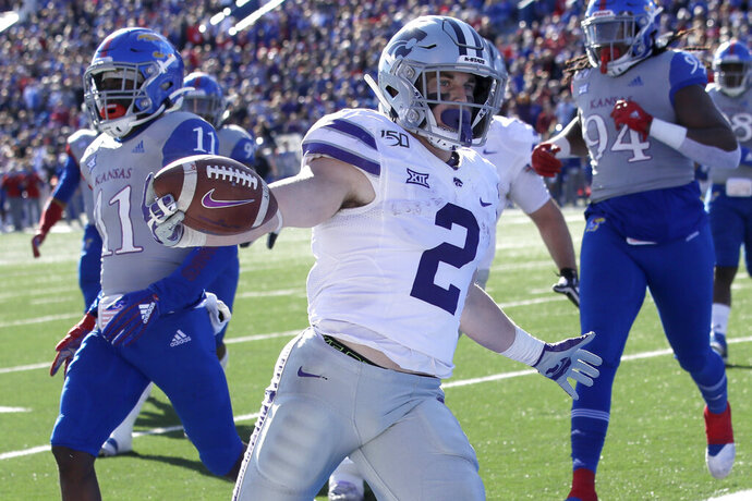 Kansas State running back Harry Trotter (2) scores a touchdown in front of Kansas safety Mike Lee (11) and defensive end Codey Cole III (94) during the first half of an NCAA college football game in Lawrence, Kan., Saturday, Nov. 2, 2019. (AP Photo/Orlin Wagner)