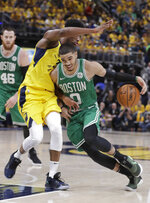 Boston Celtics forward Jayson Tatum (0) drives on Indiana Pacers forward Thaddeus Young (21) during the second half of Game 3 of an NBA basketball first-round playoff series Friday, April 19, 2019, in Indianapolis. (AP Photo/Darron Cummings)
