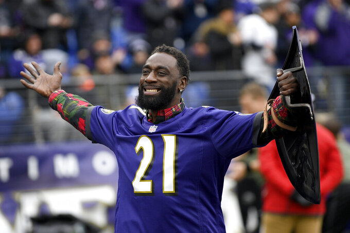 Former Baltimore Ravens safety Lardarius Webb is introduced onto the field prior to an NFL football game between the Ravens and the Houston Texans, Sunday, Nov. 17, 2019, in Baltimore. (AP Photo/Nick Wass)