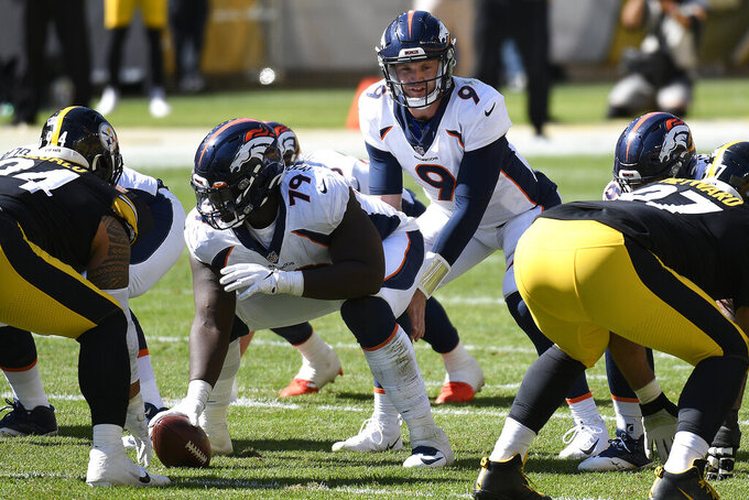Denver Broncos quarterback Jeff Driskel (9) calls signals during the second half of an NFL football game against the Pittsburgh Steelers in Pittsburgh, Sunday, Sept. 20, 2020. (AP Photo/Don Wright)