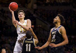 Notre Dame's Nate Laszewski (14) goes up for a shot over Wake Forest's Torry Johnson (11) and Olivier Sarr (30) during the second half of an NCAA college basketball game Wednesday, Jan. 29, 2020, in South Bend, Ind. Notre Dame won 90-80. (AP Photo/Robert Franklin)