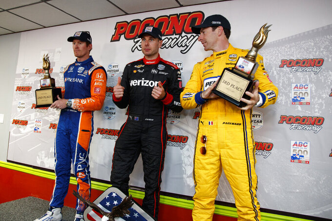 Will Power, center, poses after winning the IndyCar Series auto race at Pocono Raceway with second place finisher Scott Dixon, left, and third place finisher Simon Pagenaud, Sunday, Aug. 18, 2019, in Long Pond, Pa. (AP Photo/Matt Slocum)
