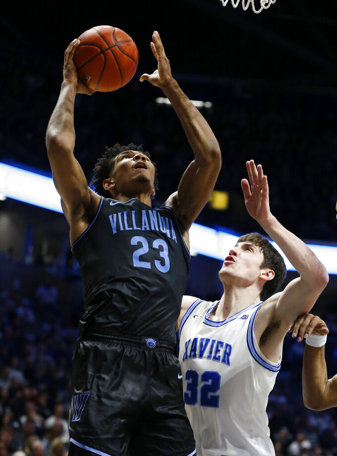 Villanova forward Jermaine Samuels (23) shoots over Xavier forward Zach Freemantle (32) during the second half of an NCAA college basketball game, Saturday, Feb. 22, 2020, in Cincinnati.  (AP Photo/Gary Landers)