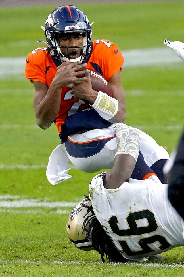 Denver Broncos quarterback Kendall Hinton (2) is tackled by New Orleans Saints outside linebacker Demario Davis (56) during the second half of an NFL football game, Sunday, Nov. 29, 2020, in Denver. (AP Photo/Jack Dempsey)
