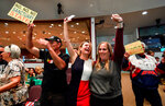 FILE - In this March 27, 2018, file photo, David Hernandez, left, Genevieve Peters, center, and Jennifer Martinez celebrate after the Orange County Board of Supervisors voted to join the U.S. Department of Justice lawsuit against the State of California's sanctuary cities law (SB54) during their meeting in Santa Ana, Calif. Leaders of California's second-largest county voted Tuesday, April 17, 2018, to officially support the Trump administration's lawsuit against the state's so-called sanctuary law that limits police cooperation with federal immigration agents. . (Jeff Gritchen/The Orange County Register via AP, File)