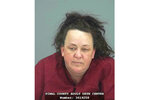 This booking photo provided by Pinal County Sheriff's Office shows Machelle Hobson. Authorities say, Tuesday, March 19, 2019,  Hobson is accused of abusing seven adopted children, including using pepper spray on them and locking them in a closet.  Hobson was booked into the Pinal County Jail on suspicion of two counts of molestation of a child, seven counts of child abuse and five counts each of unlawful imprisonment and child neglect.  (Pinal County Sheriff's Office via AP)