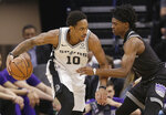 San Antonio Spurs guard DeMar DeRozan, left, works against Sacramento Kings guard De'Aaron Fox during the first quarter of an NBA basketball game Monday, Feb. 4, 2019, in Sacramento, Calif.(AP Photo/Rich Pedroncelli)