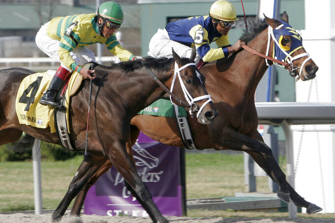 FILE - Jockey Patrick Husbands aboard Sealy Hill, right, wins by a neck against Panty Raid ridden by Edgar Prado, in the Bourbonette Breeders' Cup horse race at Turfway Park in Florence, Ky., in this Saturday, March 24, 2007, file photo. Husbands, who is from Barbados, rode Seaside Retreat in the 2006 Kentucky Derby. Kendrick Carmouche, on Saturday, May 1, 2021, will be the first Black Jockey in the Kentucky Derby since 2013 and just the fourth in the past century. (AP Photo/David Kohl, File)