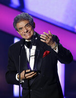 FILE - In this April 25, 2013 file photo, Jose Jose receives the Billboard Lifetime Achievement Award at the Latin Billboard Awards in Coral Gables, Fla. Local media outlets report that the Mexican crooner died Saturday, Sept. 28, 2019 from pancreatic cancer. He was 71. (AP Photo/Alan Diaz, File)