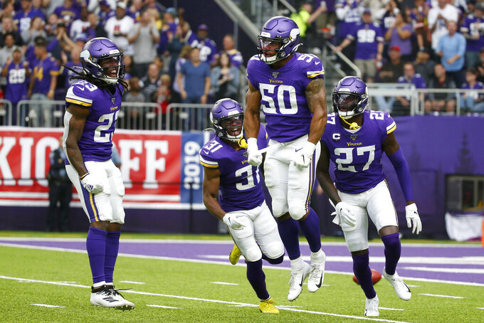 Minnesota Vikings linebacker Eric Wilson (50) celebrates with teammates after blocking a punt during the first half of an NFL football game against the Atlanta Falcons, Sunday, Sept. 8, 2019, in Minneapolis. (AP Photo/Bruce Kluckhohn)