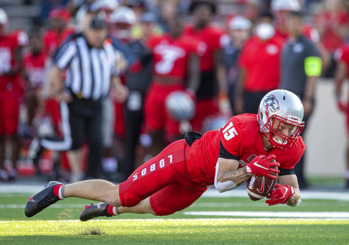 New Mexico wide receiver Luke Wysong catches a pass during the first half of the team's NCAA college football game against Houston Baptist on Thursday, Sept. 2, 2021, in Albuquerque, N.M. (AP Photo/Andres Leighton)