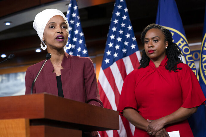 U.S. Rep. Ilhan Omar, D-Minn., joined at right by U.S. Rep. Ayanna Pressley, D-Mass., responds to remarks by President Donald Trump after he called for four Democratic congresswomen of color to go back to their