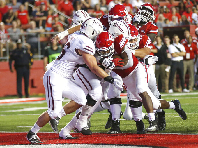 Rutgers running back Isaih Pacheco (1) fights his way into the end zone for a 2-yard touchdown against Massachusetts during the first quarter of an NCAA college football game Friday, Aug. 30, 2019, in Piscataway, N.J. (Andrew Mills/NJ Advance Media via AP)