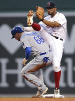 Boston Red Sox shortstop Xander Bogaerts, right, high steps around Kansas City Royals' Ryan O'Hearn (66) after making the force out during the second inning of a baseball game at Fenway Park in Boston, Wednesday, Aug. 7, 2019. Billy Hamilton was safe at first. (AP Photo/Charles Krupa)