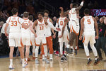 Texas players react after defeating Lipscomb in the championship basketball game of the National Invitational Tournament, Thursday, April 4, 2019, at Madison Square Garden in New York. Texas won 81-66. (AP Photo/Mary Altaffer)