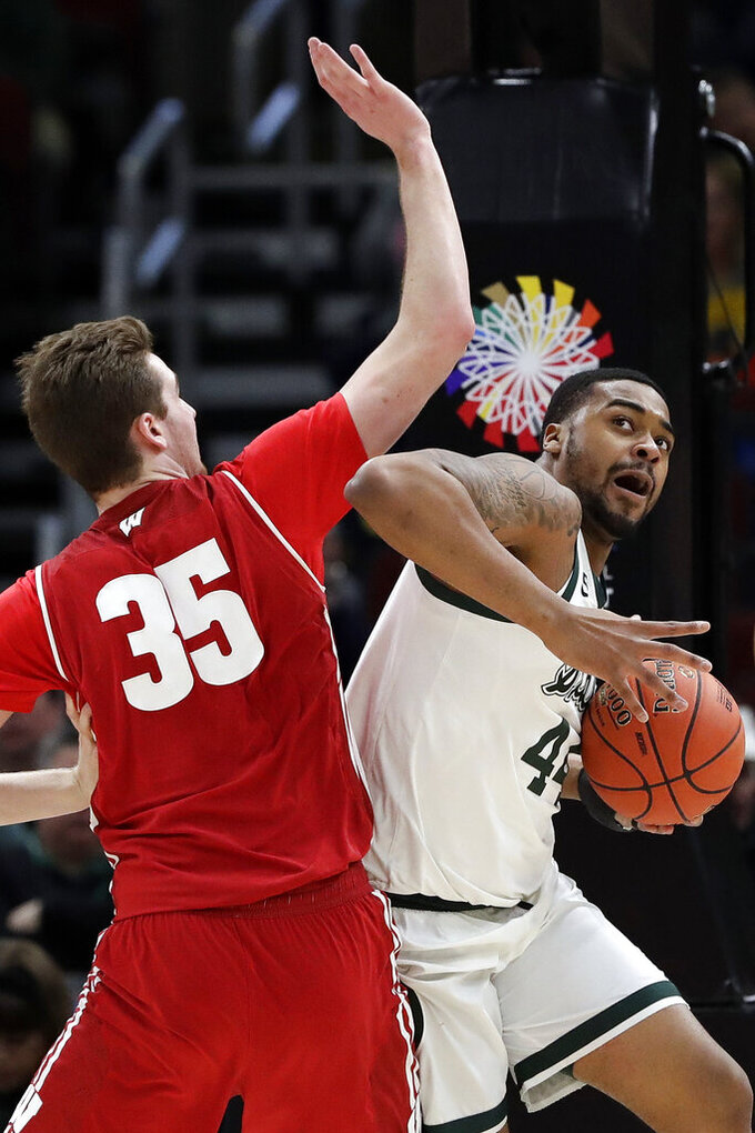 Michigan State's Nick Ward (44) drives against Wisconsin's Nate Reuvers (35) during the first half of an NCAA college basketball game in the semifinals of the Big Ten Conference tournament, Saturday, March 16, 2019, in Chicago. (AP Photo/Nam Y. Huh)