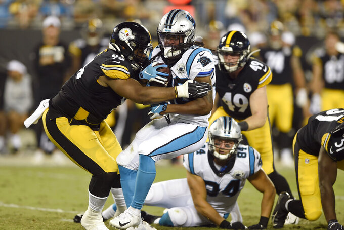 Pittsburgh Steelers defensive tackle Isaiah Buggs (96) tackles Carolina Panthers running back Jordan Scarlett (20) during the first half of an NFL preseason football game in Charlotte, N.C., Thursday, Aug. 29, 2019. (AP Photo/Mike McCarn)