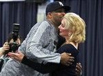 New York Yankees starting pitcher CC Sabathia, left, hugs Jenny Steinbrenner Swindal, right, at the New York Yankees spring training baseball facility, Saturday, Feb. 16, 2019, in Tampa, Fla. (AP Photo/Lynne Sladky)
