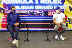 Williams driver George Russell of Britain, left, and Mercedes driver Valtteri Bottas of Finland attend a media conference prior to the Belgian Formula One Grand Prix at the Spa-Francorchamps racetrack in Spa, Belgium, Thursday, Aug. 26, 2021. (Xpb Images.com, Pool via AP)