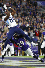 Tennessee Titans wide receiver Corey Davis (84) makes a touchdown catch against Baltimore Ravens free safety Earl Thomas (29) during the second half an NFL divisional playoff football game, Saturday, Jan. 11, 2020, in Baltimore. (AP Photo/Julio Cortez)
