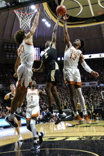 Purdue guard Eric Hunter Jr. (2) shoots in front of Texas guard Jase Febres (13) in the second half of an NCAA college basketball game in West Lafayette, Ind., Saturday, Nov. 9, 2019. Texas won 70-66. (AP Photo/AJ Mast)