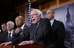 Sen. Bernie Sanders, I-Vt., center, joined from left by Sen. Richard Blumenthal, D-Conn., Rep. Peter Welch, D-Vt., Rep. Elijah Cummings, D-Md., and Sen. Cory Booker, D-N.J., speaks to reporters as he prepares to introduce new legislation that aims to reduce what Americans pay for prescription drugs, especially brand-name drugs deemed