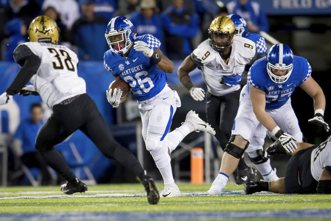 Kentucky running back Benny Snell Jr. (26) during the second half of an NCAA college football game against Vanderbilt in Lexington, Ky., Saturday, Oct. 20, 2018. Kentucky won, 14-7. (AP Photo/Bryan Woolston)