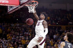 File-This March 7, 2020, file photo shows Arizona State forward Romello White (23) dunking during the second half of an NCAA college basketball game against Washington State in Tempe, Ariz. White can play immediately for Ole Miss as a graduate transfer. White, who is 6-8, averaged 10.2 points and led the Pac-12 with 8.8 rebounds per game last season. (AP Photo/Matt York, File)