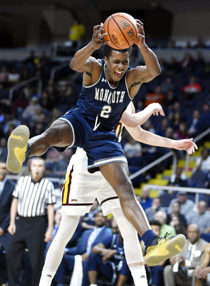 Monmouth forward Melik Martin (2) grabs a rebound during the first half of the championship NCAA college basketball game against Iona during the Metro Atlantic Athletic Conference tournament, Monday, March 11, 2019, in Albany, N.Y. (AP Photo/Hans Pennink)