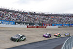 Kyle Larson, left, leads the pack of Alex Bowman, center left, William Byron, center right, and Chase Elliott, right, during a NASCAR Cup Series auto race at Dover International Speedway, Sunday, May 16, 2021, in Dover, Del. (AP Photo/Chris Szagola)