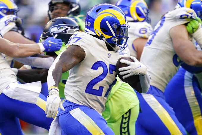 Los Angeles Rams running back Darrell Henderson (27) rushes against the Seattle Seahawks during the first half of an NFL football game, Thursday, Oct. 7, 2021, in Seattle. (AP Photo/Elaine Thompson)