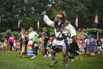 Patrick Littlewolf, of Secaucus, N.J., representing the Tuscarora Tribe, participates in an intertribal dance at Schemitzun on the Mashantucket Pequot Reservation in Mashantucket, Conn., Saturday, Aug. 28, 2021. Connecticut and a handful of other states have recently decided to mandate students be taught about Native American culture and history.  (AP Photo/Jessica Hill)
