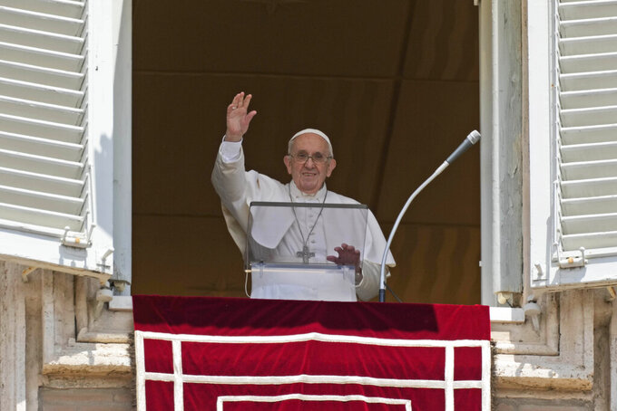 Pope Francis salutes the crowd as he arrives for the Angelus noon prayer from the window of his studio overlooking St.Peter's Square, at the Vatican, Sunday, July 18, 2021. (AP Photo/Alessandra Tarantino)